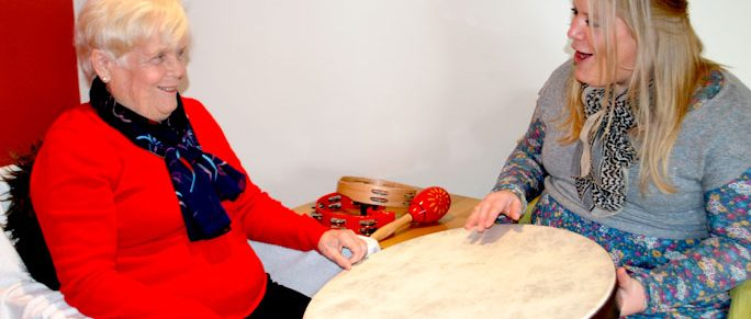 Music-therapist-elderly-drum-health-community-session